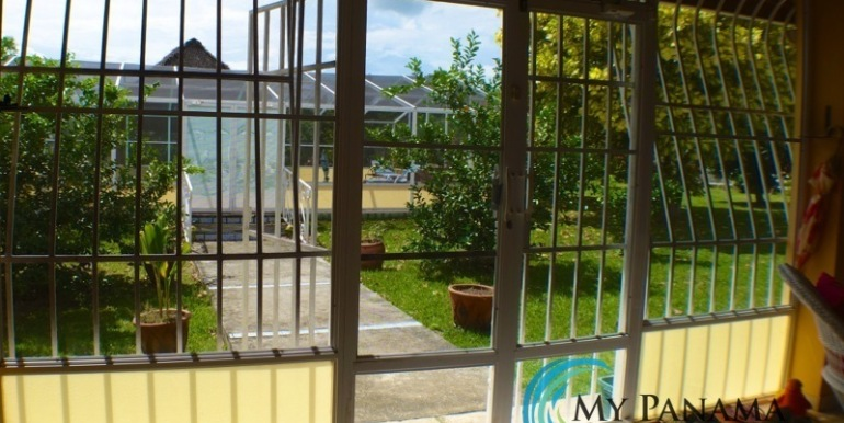 ForSale-TheCatDenTeam-MPRE-Cabuya-house-doorway-to-pool