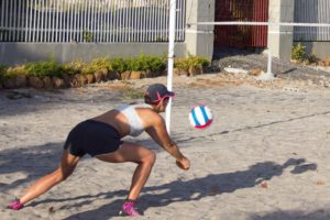 Denise sporting her pink sand socks on the volleyball court in Bahia. The court is now named in her memory.